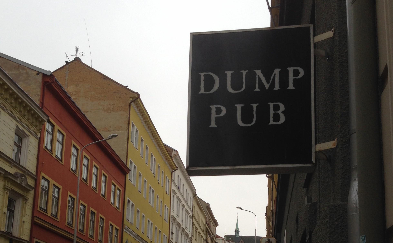 The sign outside Dump Pub in Prague
