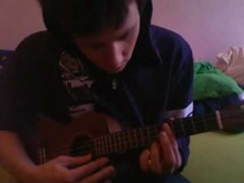 Playing the ukulele on youtube in a purple sweatshirt i used to love but no longer have